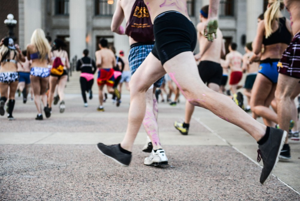 Undie Run participants start the 1.5 mile race on Friday.  The participants stripped down to their underwear and donate the clothes that they were wearing to