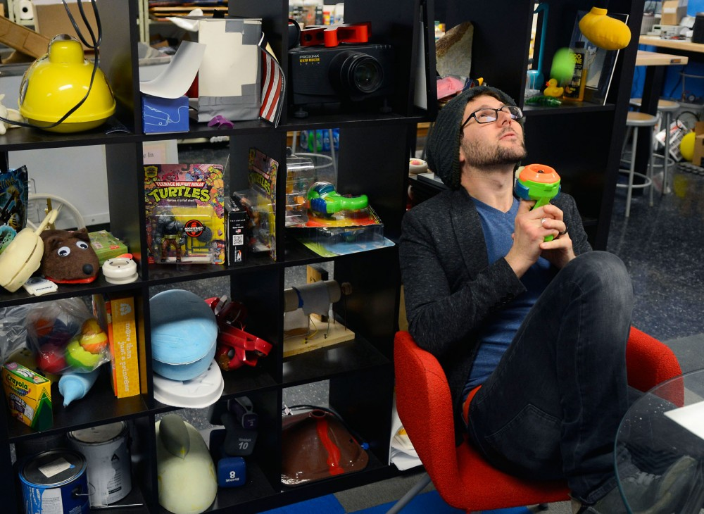 Assistant professor Barry Kudrowitz demonstrates the Atom Blaster, a Nerf toy developed from his master's research in 2005, in his office Thursday. Kudrowitz has taught a Toy Product Design course for 10 years, including four at the University of Minnesota.