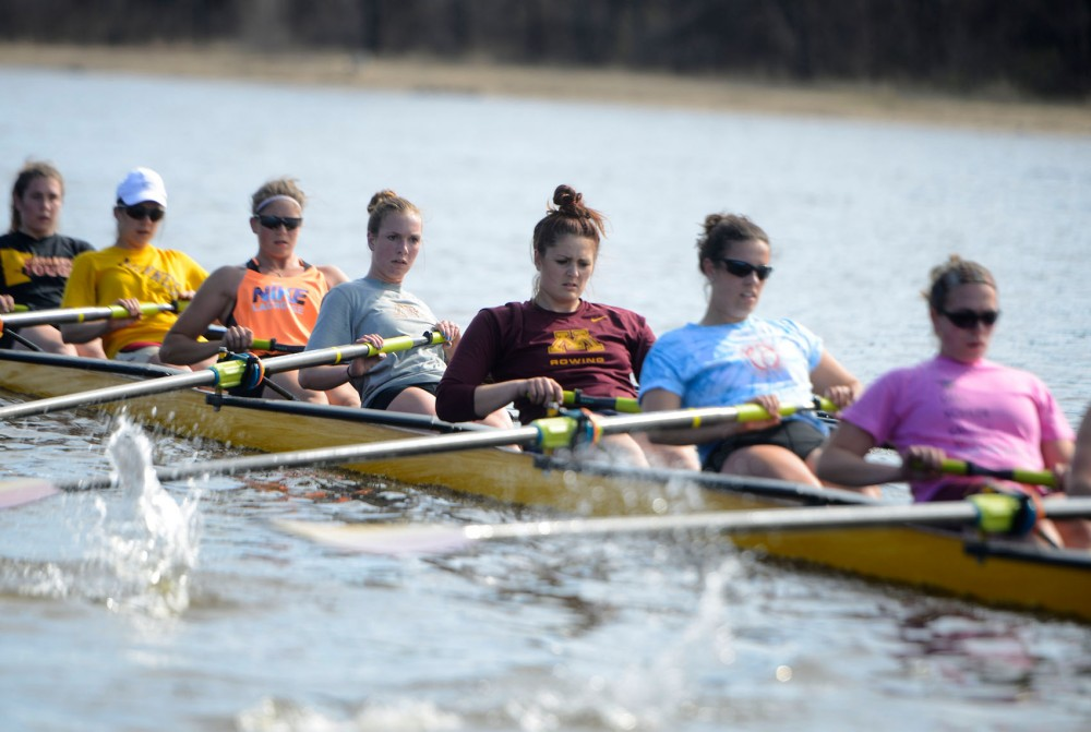 The women's rowing team practices on the Mississippi River on Tuesday afternoon in preparation for their competition against the University of Iowa on Sunday, April 27.