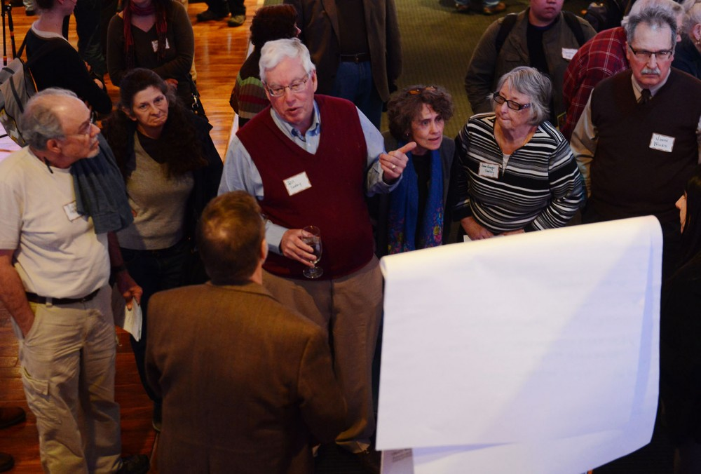 Bill Seeley and other Prospect Park residents brainstorm improvements to their neighborhood at the annual Prospect Park East River Road Improvement Association meeting at the Profile Event Center on Monday.