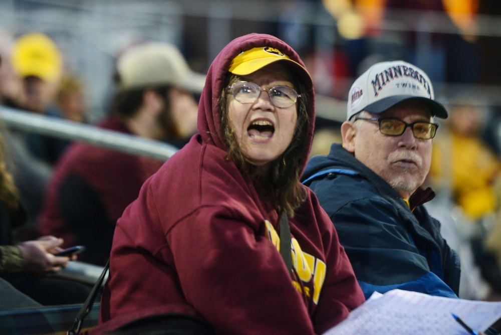 Superfan Jeannie Campion shouts to encourage the Gophers during their game against Penn State on Friday at Siebert Field. She's attended almost every home game since 1995.