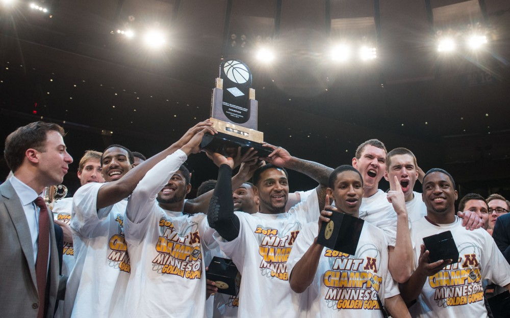 Minnesota men's basketball team hold up their first place  trophy with excitement Thursday evening at the National Invitation Tournament finals at Madison Square Garden in New York.