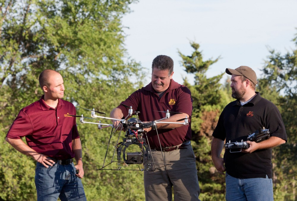 Ian Macrae with unmanned aerial vehicle (UAV, or drone) Minnesota Agricultural Experiment Station research project #17-037,