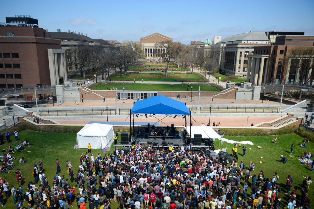 Students crowd the front lawn of Coffman on Friday for Poliça's concert on Friday as part of spring jam.