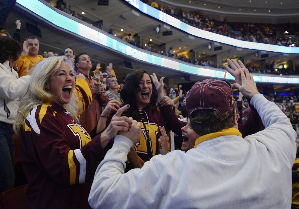 Fans celebrate after Gophers senior defenseman Justin Holl scored with 0.6 seconds left in the game to give Minnesota the dramatic 2-1 win over its longtime rival North Dakota on Thursday evening in Philadelphia.