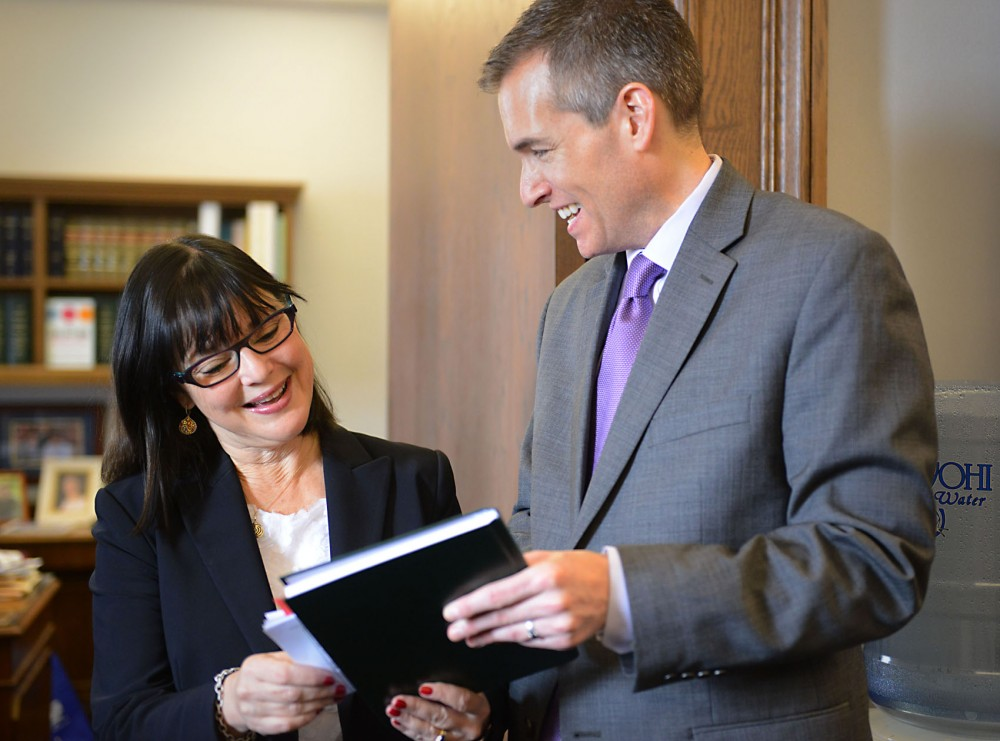 University of Minnesota head of government relations Jason Rohloff and Minnesota Sen. Terri Bonoff discuss figures from the committee meeting earlier that morning on Tuesday April 1st, 2014 at the state Capitol.