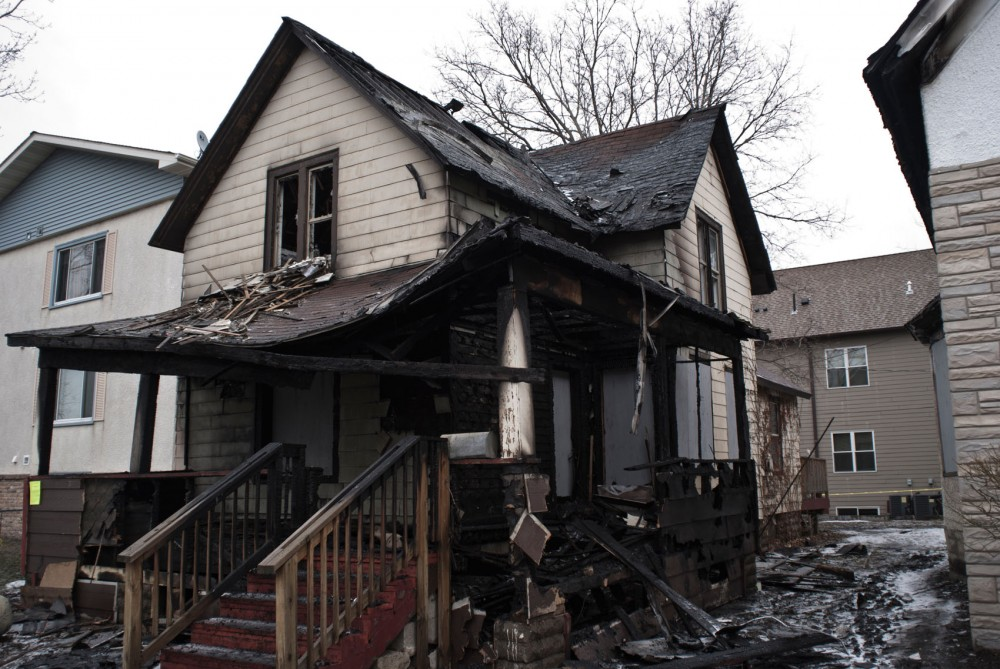 A fire partially destroyed a two-story house at 804 13th Ave. SE and left another damaged early, Thursday morning.