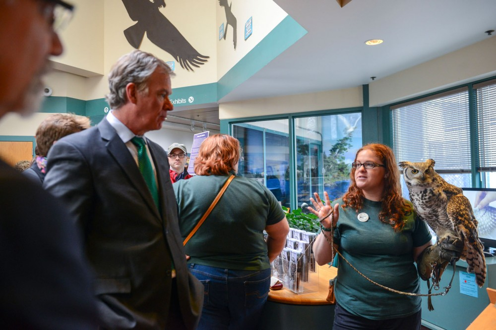 Raptor Center volunteer Rochelle Roche holds a great horned owl while explaining raptor characteristics to St. Paul Mayor Chris Coleman at the center on Thursday.