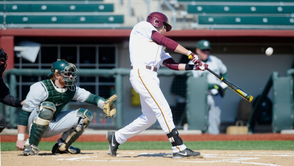 Minnesota second baseman Connor Schaefbauer bats against Michigan State on Saturday March 29, at Siebert Field.
