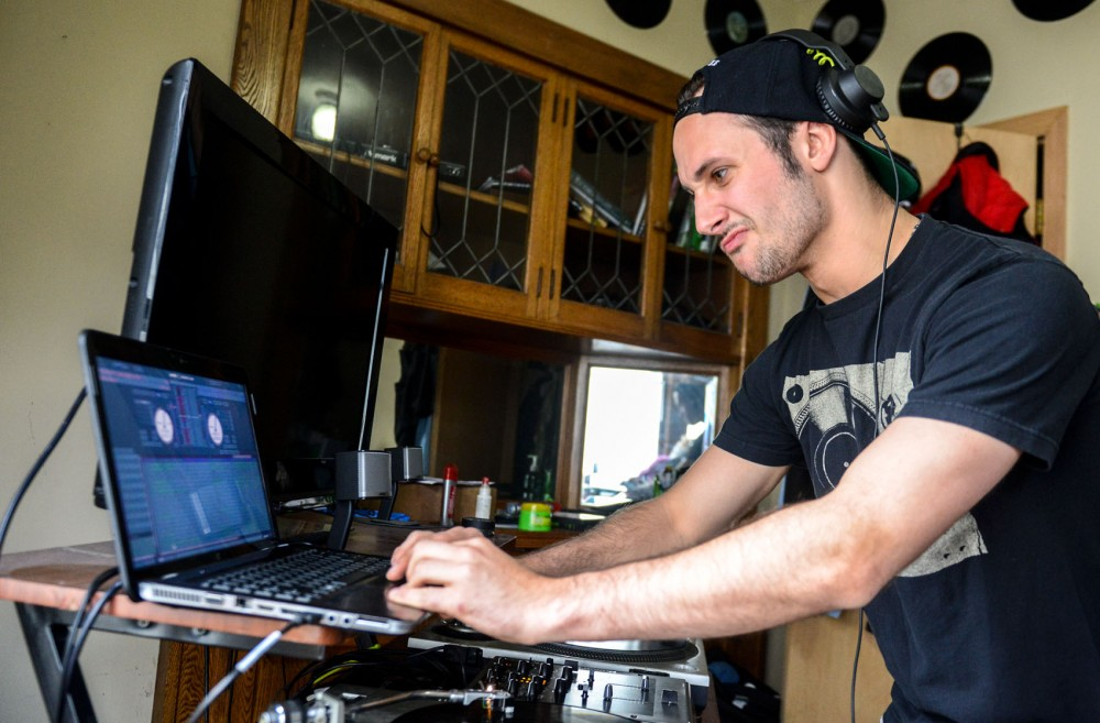 Alex Amann, also known as DJ Cfans, does live mixing in his bedroom on Saturday. Amann graduated with a B.A in food science and is now pursuing a graduate degree at the University with the asperation of becoming a flavorist.