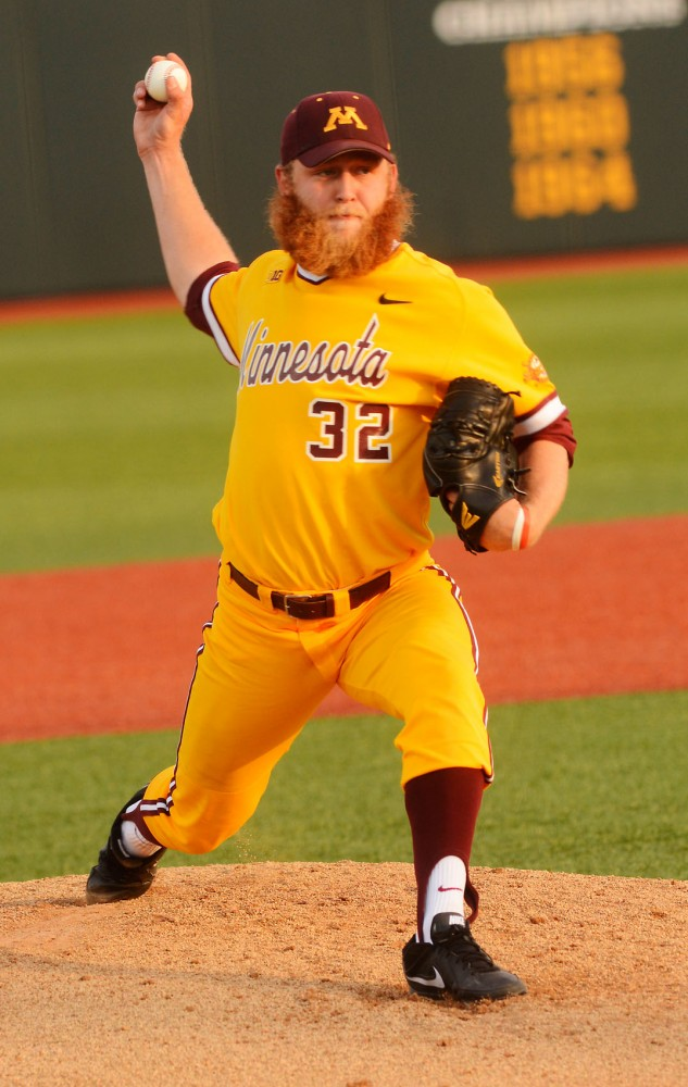 Pitcher Cody Campbell winds up to throw the ball during a game against Concordia College at Siebert Field on Wednesday.