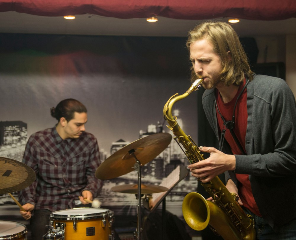 Courageous Endeavors saxophone player Nelson Devereaux, right, and drummer Miguel Hurtado, left, practice with their jazz quartet at Jazz Central Studios in Minneapolis on Thursday, May 1. Courageous Endeavors released their debut album on Tuesday, May 6.