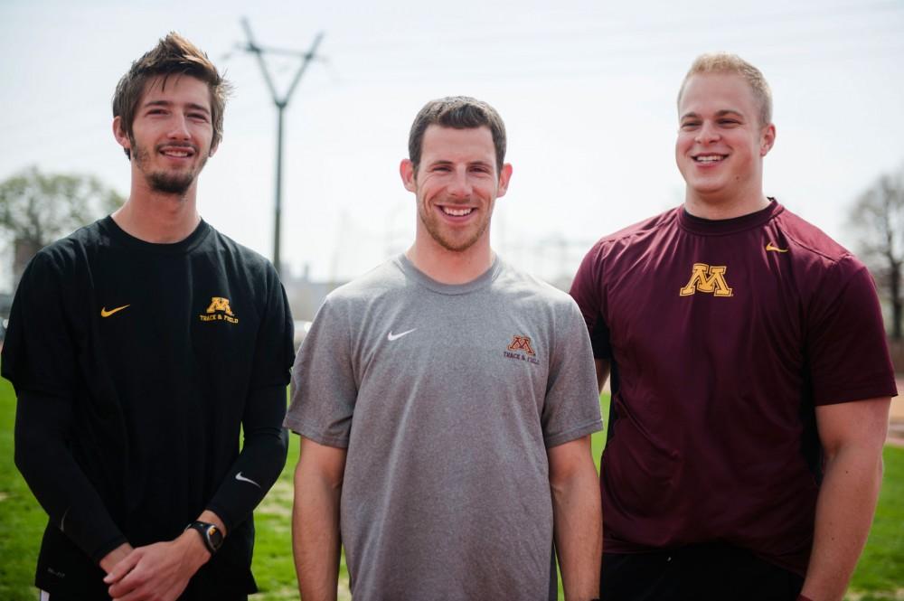 Minnesota senior track athletes John Simons, left, Zach Siegmeier, center, and Jon Lehman, right, stand on Bierman Track on Wednesday. All three are preparing for the Big Ten championships next week.