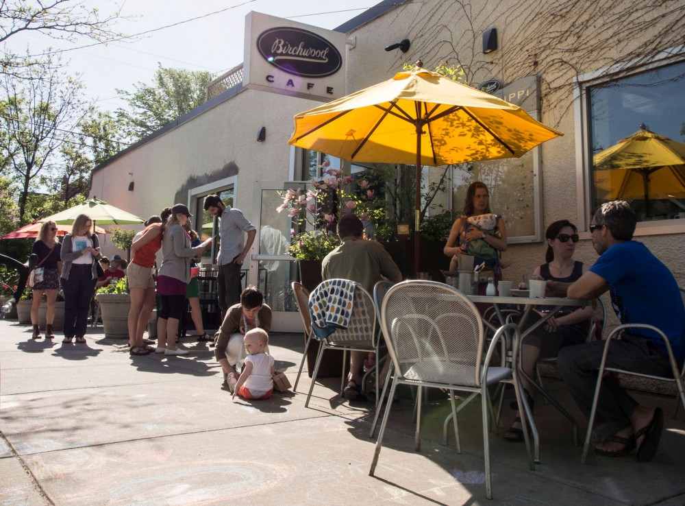 Customers sit outside the Birchwood Cafe on Sunday, May 25, 2014. The Birchwood cafe recently reopened, following its expansion and remodeling.