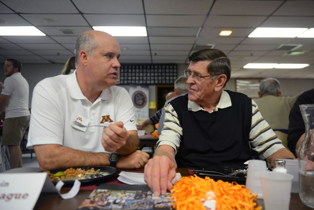 Athletic director Norwood Teague (left) talks to Gopher fan Ed Donaldson at an American Legion in Willmar, Minn. on May 20. Teague and other Gopher coaches are reaching out to fans in cities across Minnesota until June 4 for the Chalk Talk 2014.
