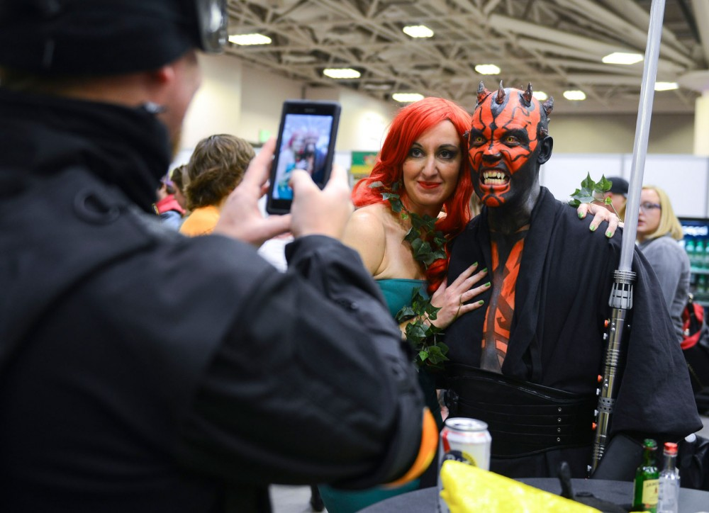 Minneapolis Comic Con attendees pose together for photos at the Convention Center on Saturday. Wizard World held its first Minneapolis Comic Con this weekend.