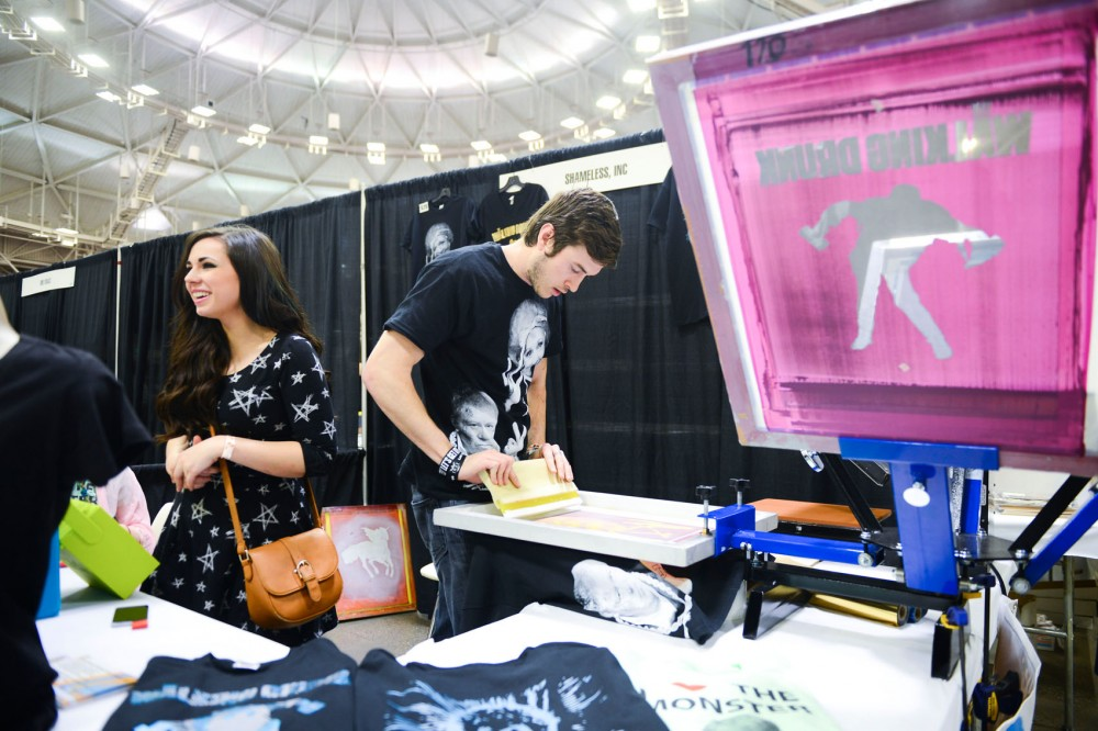 Co-owner of Shameless Inc JR screen prints t-shirts for Comic Con attendees. Wizard World held its first Minneapolis Comic Con this weekend.
