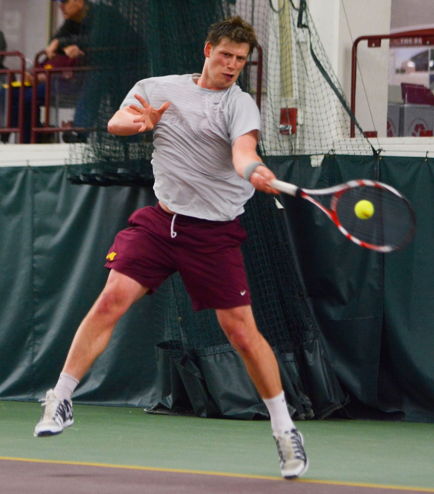 Minnesota's Leandro Toledo plays a singles match against Penn State at the Baseline Tennis Center on Sunday, April 6, 2014.