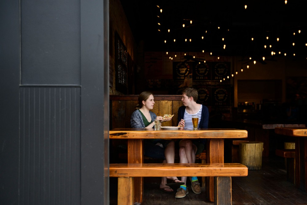 Shannon Fast and Erica Larson eat at Punch Pizza on Washington Avenue on Monday.