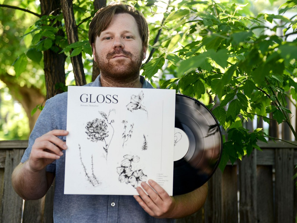 Founder of Forged Artifacts Matt Linden displays  the label's most recent vinyl release, Between Themselves by Gloss, outside of his home on Friday. Linden started the label in 2012