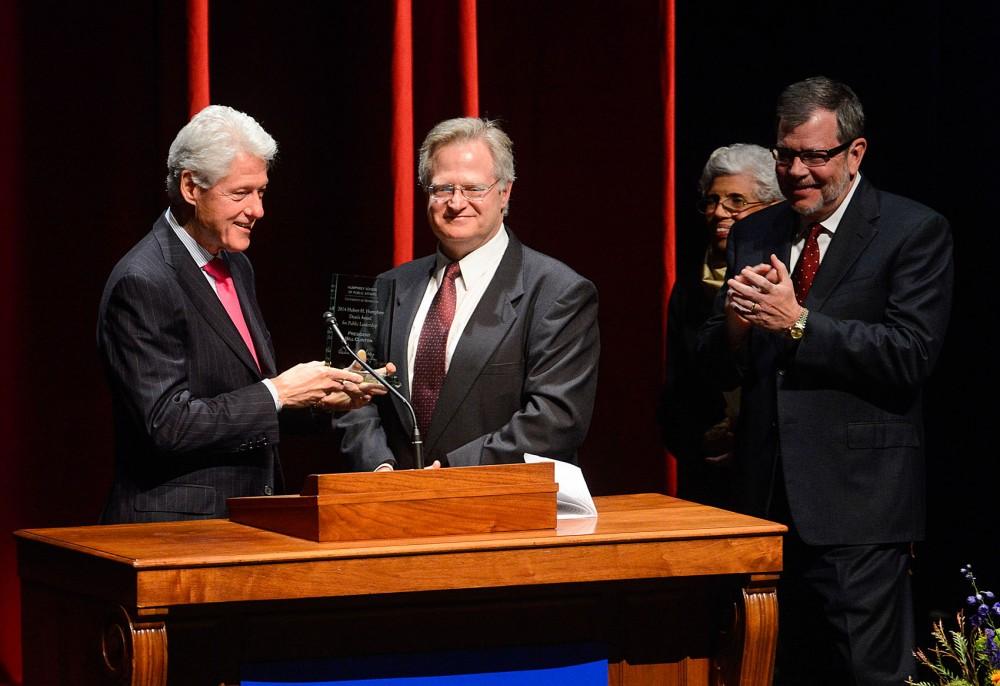 Former President Bill Clinton accepts the dean
