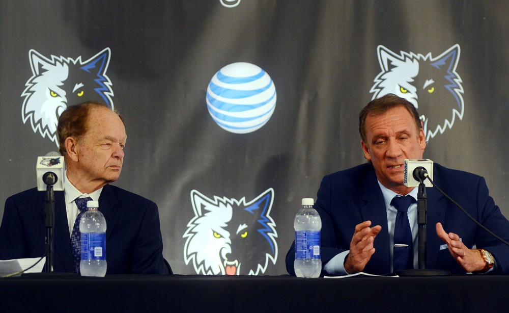 University alumnus and Minnesota Timberwolves president of basketball operations Flip Saunders, right, addresses the media while team owner Glen Taylor, left, listens during a press conference at Target Center in Minneapolis on Friday. Saunders is newly-appointed as head coach for the Minnesota Timberwolves.