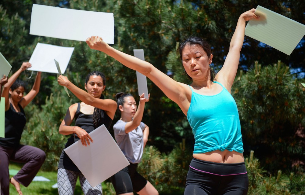 Hui Niu Wilcox of the Ananya Dance Theatre rehearses a piece titled ìBlue Dream Journeysî with other dancers from the troupe on Sunday outside Barbara Barker Center for Dance. The group will perform the piece with the public during Northern Spark, a city-wide all-night art festival.