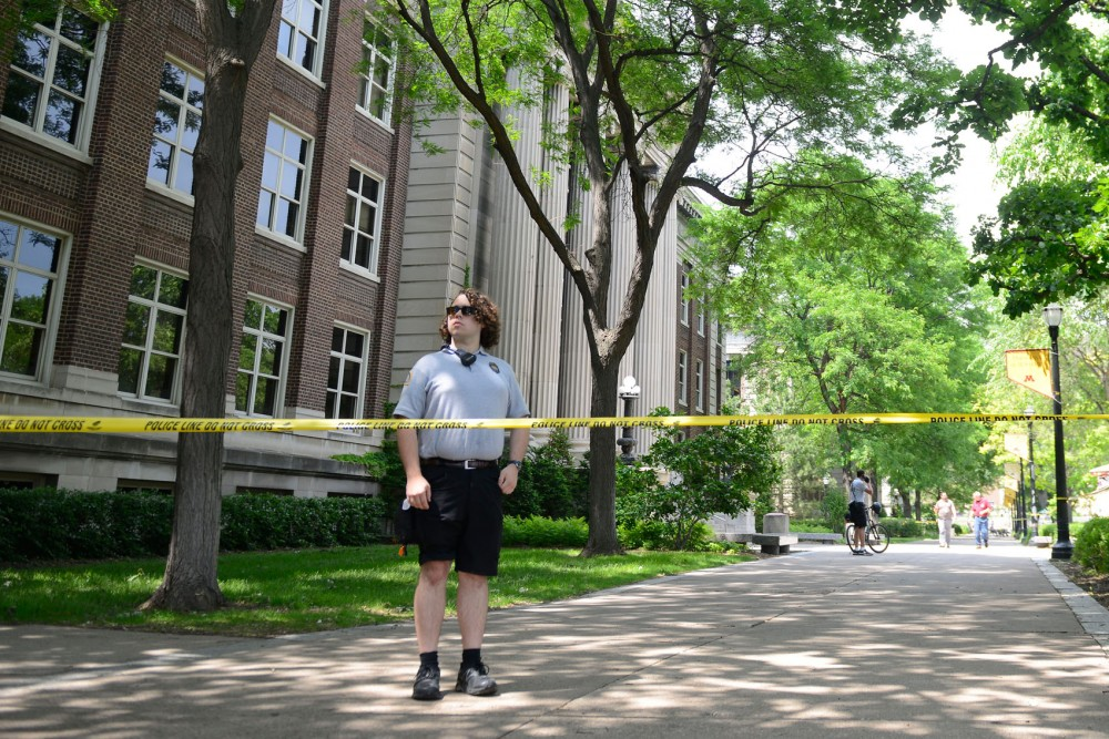 A University security monitor stands outside Smith Hall after a research-related chemical explosion Tuesday afternoon.