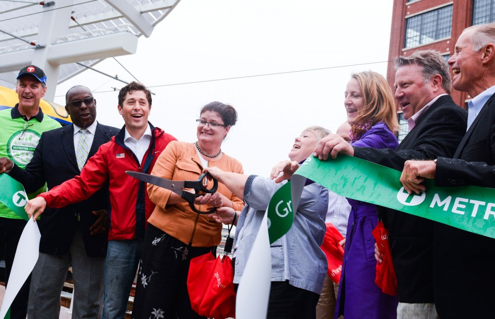 Metropolitan Council members Wendy Wulff and Linda Higgins cut the ceremonial ribbon for the grand opening of  the Green Line at Target Field Station on Saturday.