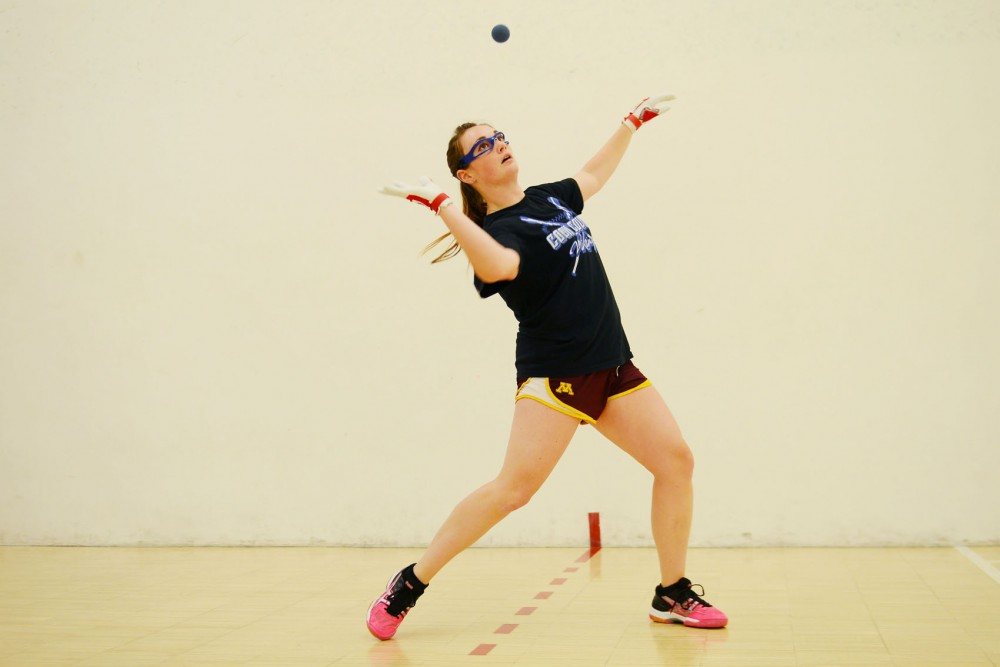 Kinesiology senior Kristina Rude warms up before her game in the 64th United States Handball Association National Four-Wall Championships at the Recreational and Wellness Center on Saturday. Rude was __