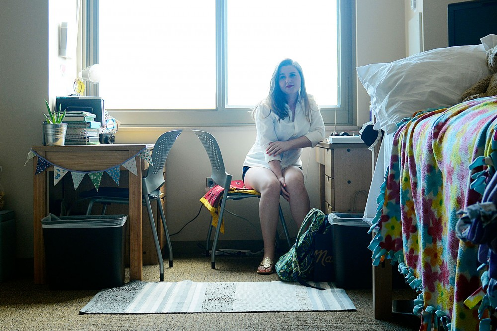 Sophomore Maddie Blake sits at her desk in 17th Avenue Residence Hall on Friday. Blake is not planning to return to on-campus housing in the fall, but her roommate Stephanie Murch is.