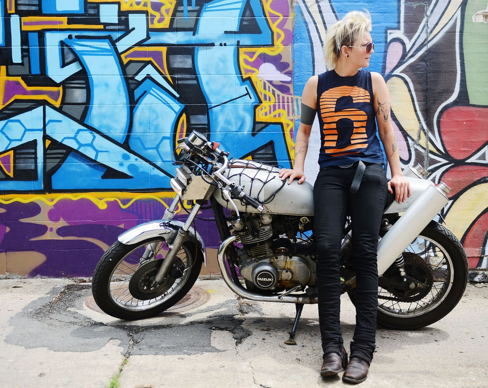 Angie Oase of the band Pennyroyal poses with her bike on Sunday. Pennyroyal will be playing at Twin Cities Pride on June 28th. In addition, Oase plans on riding her bike with Dykes on Bikes, a lesbian motorcycle club, during the parade at Pride.