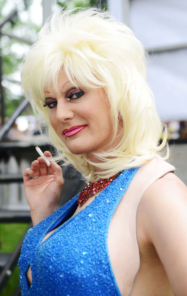 Performer Prada Dior smokes a cigarette before her performance on the Stonewall Stage at the Twin Cities Pride festival at Loring Park on Saturday.