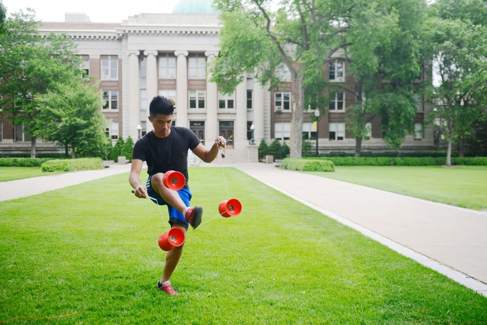 Sophomore Yang Yang practices diabolo tricks on Northrop Mall on Monday afternoon. Yang started juggling diabolos five years ago and performs for a circus in Kentucky.