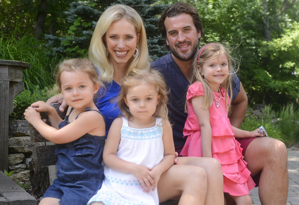 Former Gophers football player Ben Utecht  poses with his wife, Karyn, and his three daughters Katriel, Amy and Elleora at their home in Lakeville, Minn.