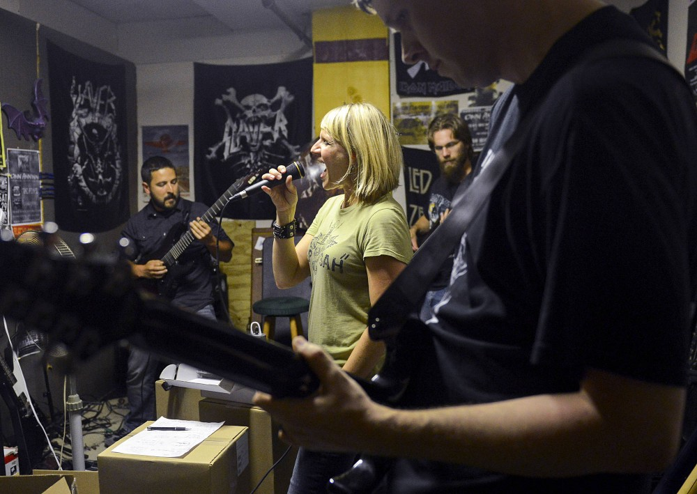 Cwn Annwn members practice at Kooler Sound in St. Paul on Thursday. The melodic metal band formed in 1997.