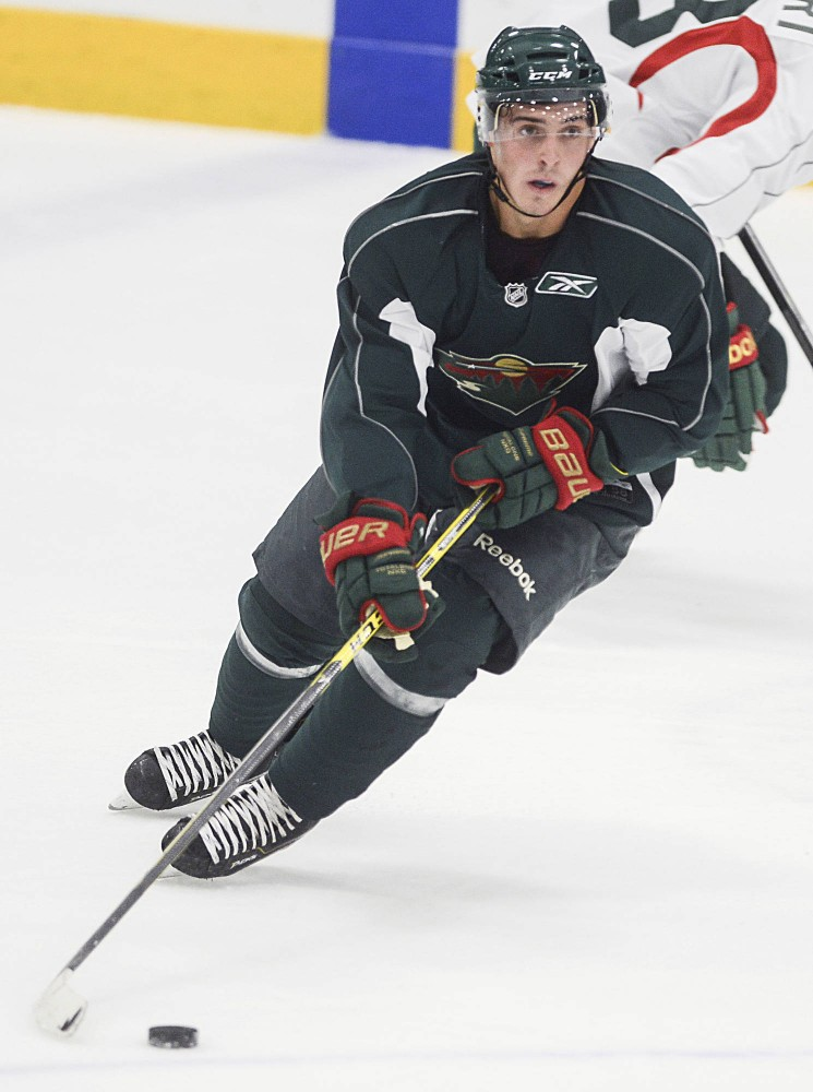 Rising sophomore Vinni Lettieri skates with the puck during at a scrimmage for the Wild Development Camp at Braemar Arena in Edina on Friday. Former Gophers goalie Michael Shibrowski also participated in the camp.