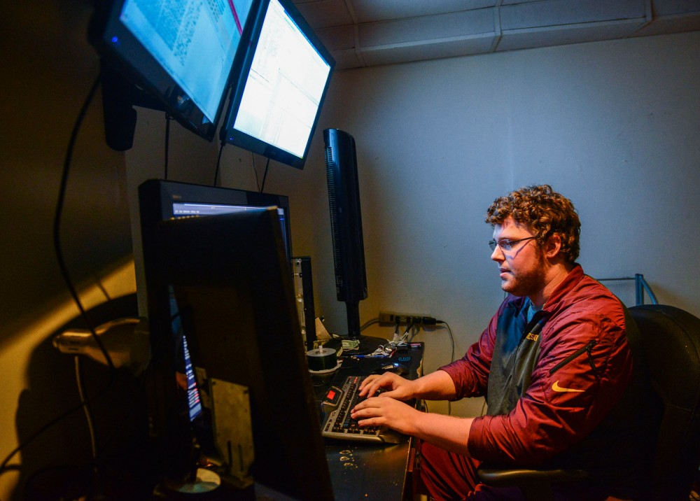 Former Gophers offensive lineman Caleb Bak demonstrates website vulnerability analysis in his home on Tuesday, July 15. Bak quit football due to concussions and is now trying to make hacking a career.