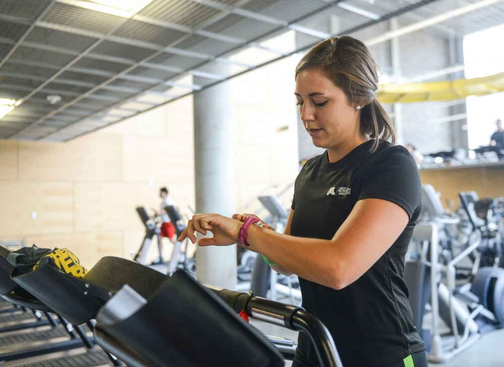 Alyssa Melco, senior kinesiology student, uses a Polar FT40 heart rate monitor watch during a workout on Thursday at the University Recreation & Wellness Center.  She uses the watch primarily during interval workouts to track her heart rate training zones.