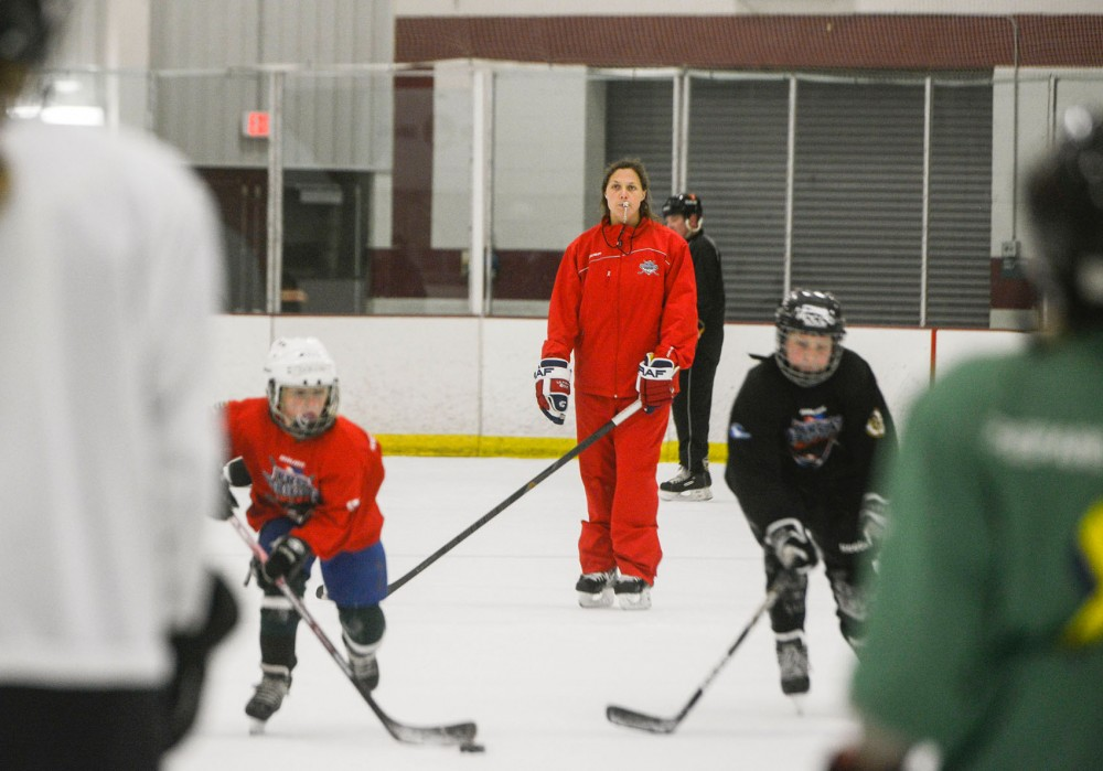 Olympian and former Gophers women's hockey player Megan Bozek coaches kids at a Pro Ambitions camp at Schwan Super Rink at the National Sports Center in Blaine. Bozek spends her summers coaching for Pro Ambitions at camps around the country.