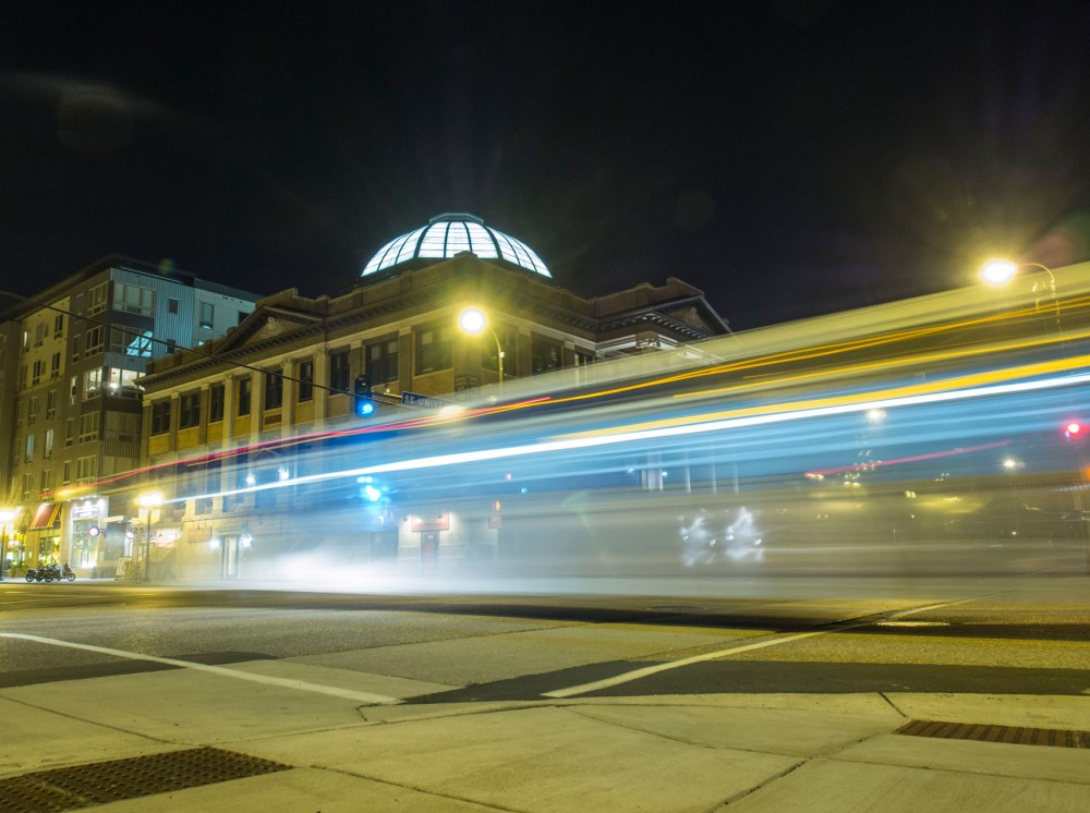 A bus drives past Dinkydome apartments Tuesday night