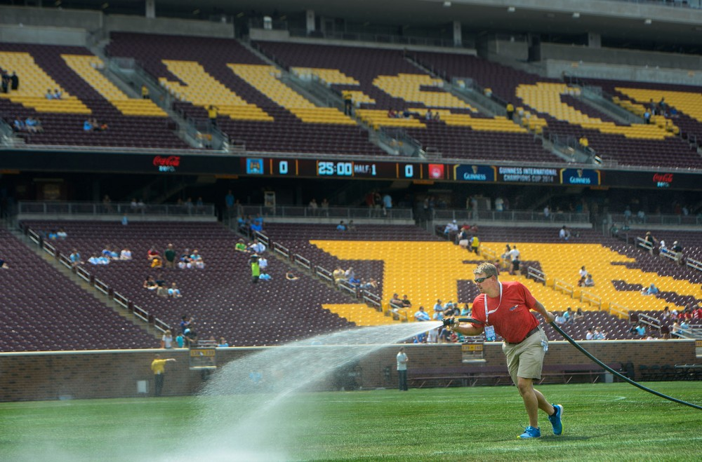 Alan Wolf, assistant superintendent of The Motz Group, waters the field at TCF Bank Stadium on Aug. 2, 2014. Natural sod was installed for a soccer doubleheader.