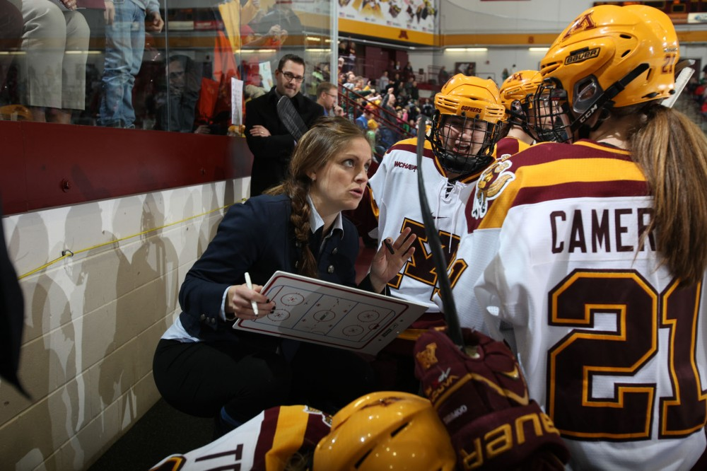 Gophers women's hockey assistant coach Nadine Muzerall talks to the forwards during a game against North Dakota Nov. 16, 2013.