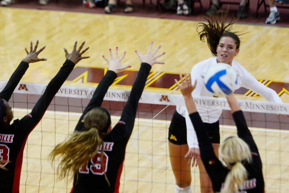 Gohpers outside hitter Sarah Wilhite hits the ball past Louisville on Saturday night at the Sports Pavilion.
