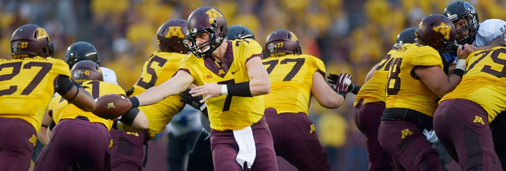Minnesota quarterback Mitch Leidner hands the ball to running back David Cobb on Thursday evening against Eastern Illinois at TCF Bank Stadium.