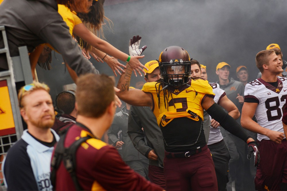Minnesota defensive back Derrick Wells enters TCF Bank Stadium on Thursday evening before the game against Eastern Illinois.