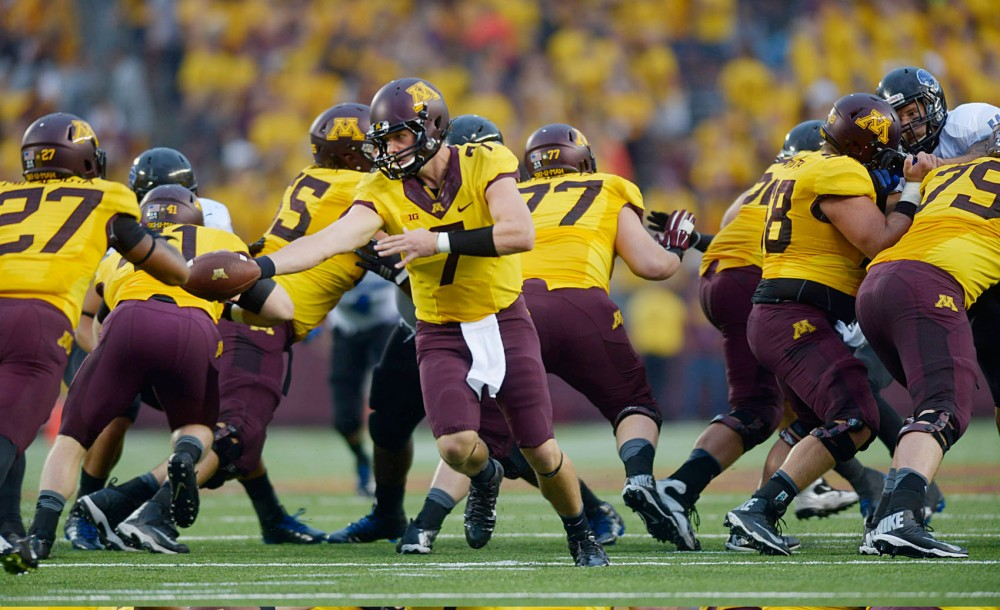 Minnesota quarterback Mitch Leidner hands off the ball to running back David Cobb on Thursday evening against Eastern Illinois at TCF Bank Stadium.