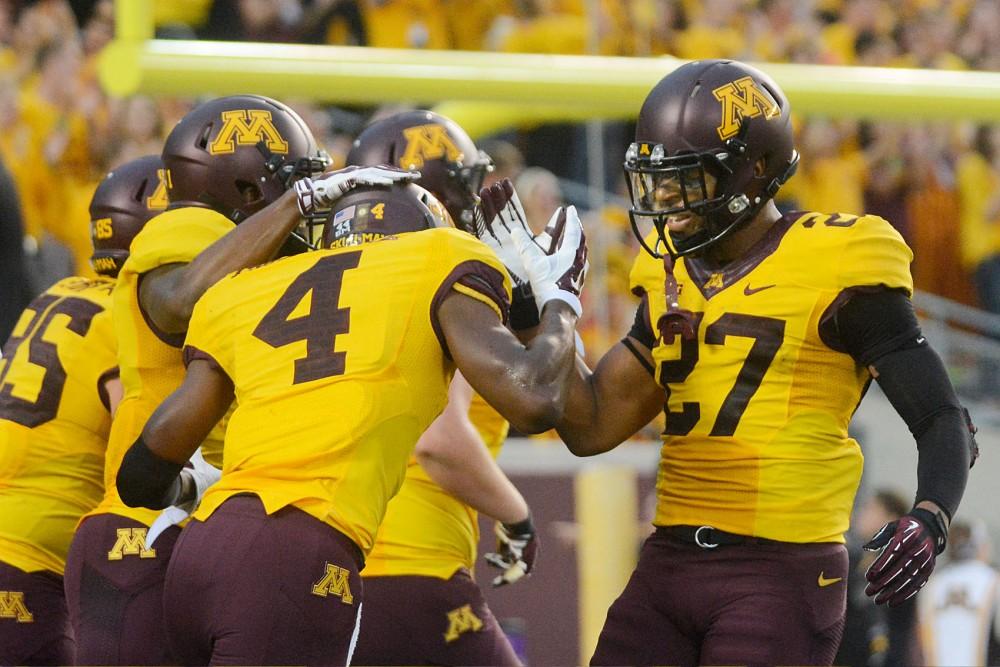 Minnesota running back David Cobb celebrates Donovahn Jones's touchdown Thursday evening at TCF Bank Stadium.