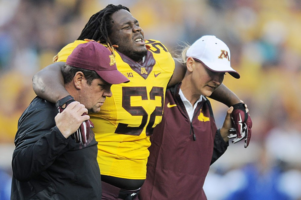 Minnesota defensive lineman Yoshoub Timms walks off the field after an injury  on Thursday, Aug. 28 against Eastern Illinois at TCF Bank Stadium. Timms is one of three players that left the game injured Thursday.