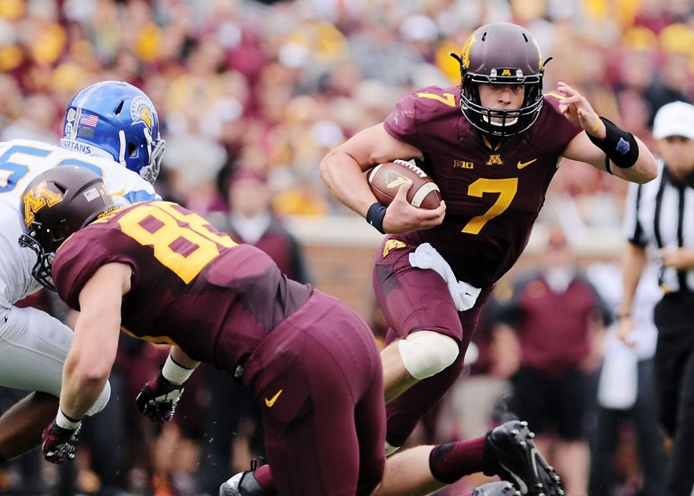 Minnesota quarterback Mitch Leidner runs past San Jose State on Saturday, September 21, 2013 at TCF Bank Stadium.